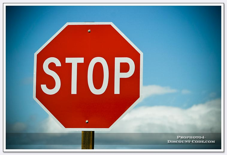 Stop-sign-blue-sky-and-clouds